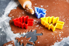 Baking ginger bread cookies as Christmas trees with colorful for Royalty Free Stock Photography