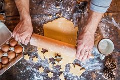 Baking gingerbread cookies at Christmas time. Stock Images