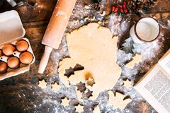 Baking gingerbread cookies at Christmas time. Royalty Free Stock Photos
