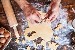 Baking gingerbread cookies at Christmas time. Stock Photos