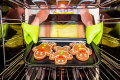 Baking Gingerbread man in the oven Royalty Free Stock Image