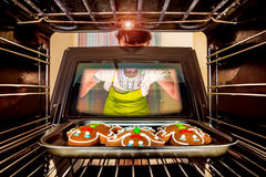 Baking Gingerbread man in the oven Royalty Free Stock Photo