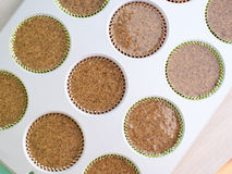 Baking gluten free muffins Stock Photo