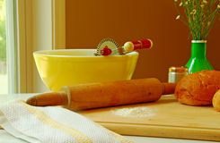 Baking In Grandma's Kitchen. Old fashioned mixer, mixing bowl, and rolling pin alongside freshly baked bread royalty free stock images
