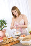 Baking - Happy woman prepare healthy ingredients Stock Photography