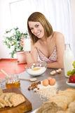 Baking - Happy woman prepare healthy ingredients Royalty Free Stock Photography