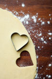 Baking heart cookies Stock Images
