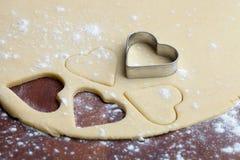 Baking heart cookies Stock Photography