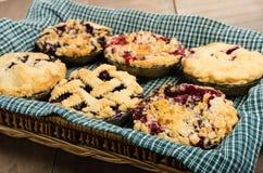 Baking homemade fresh fruit pies Stock Photo
