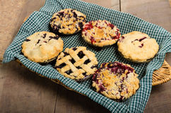 Baking homemade fresh fruit pies Royalty Free Stock Images