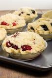 Baking homemade fresh fruit pies Royalty Free Stock Image