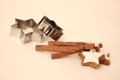 Baking ingredients. Baking cutter with cinnamon and some sweets Royalty Free Stock Images