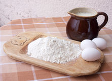 Baking ingredients. Ingredients for baking on table top: eggs, milk and flour Royalty Free Stock Image