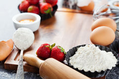 Baking ingredients and berries Royalty Free Stock Photos