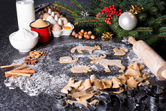 Baking ingredients for Christmas cookies gingerbread. Molds for baking, spices and  decorations for Christmas. Stock Photo