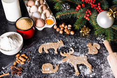 Baking ingredients for Christmas cookies gingerbread. Molds for baking, spices and  decorations for Christmas. Stock Photography