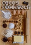 Baking ingredients for christmas cookies. With wooden pieces and the words MERRY CHRISTMAS burned into them Stock Images