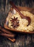 Baking ingredients Cinnamon sticks, star anise and brown sugar. Stock Photo