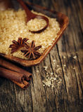 Baking ingredients Cinnamon sticks, star anise and brown sugar. Stock Image