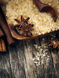 Baking ingredients Cinnamon sticks, star anise and brown sugar. Stock Images