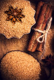 Baking ingredients Cinnamon sticks,  star anise and cane brown s Stock Image