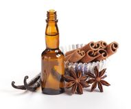 Baking ingredients. Close-up of vanilla beans, anise stars, cinnamon sticks in paper cupcakes and baking flavor in a bottle stock images