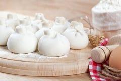 Baking ingredients for cooking manti dumplings. Stock Photo