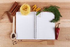 Baking ingredients for cooking and notebook for recipes. Baking ingredients for cooking and notebook for recipes on a wooden board Royalty Free Stock Image