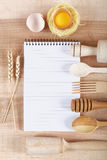 Baking ingredients for cooking and notebook for recipes. Royalty Free Stock Photo