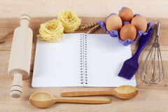Baking ingredients for cooking and notebook for recipes. Royalty Free Stock Photography