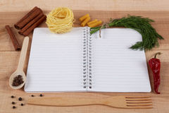 Baking ingredients for cooking and notebook for recipes. Baking ingredients for cooking and notebook for recipes on a wooden board Royalty Free Stock Photography