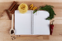 Baking ingredients for cooking and notebook for recipes. Royalty Free Stock Image
