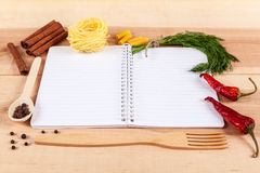 Baking ingredients for cooking and notebook for recipes. Stock Photos