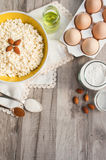 Baking Ingredients. Ingredients for baking. Cottage cheese, vegetable oil, eggs, flour, almonds, sugar, cinnamon. In the background of the composition is used Royalty Free Stock Photography