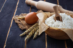 Baking ingredients egg, flour, rolling pin Stock Photography