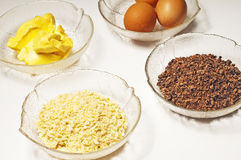 Baking ingredients,egg, margarine,almond,chocolate Royalty Free Stock Photo