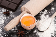 Baking ingredients with egg yolk. Baking background with flour, ingredients, rolling pin, making  dough and  pastry, homemade, preparation, recipe utensils,egg Royalty Free Stock Photos
