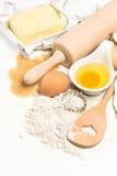 Baking ingredients eggs, flour, sugar, butter. kitchen utensils