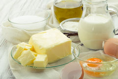 Baking ingredients eggs, flour, sugar, butter, vanilla, cream Stock Images