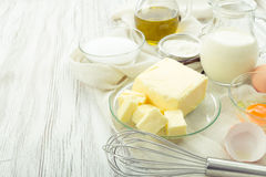 Baking ingredients eggs, flour, sugar, butter, vanilla, cream Stock Photography