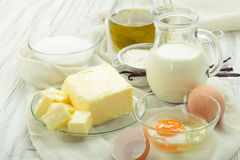 Baking ingredients eggs, flour, sugar, butter, vanilla, cream Royalty Free Stock Photo