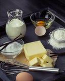 Baking ingredients eggs, flour, sugar, butter, vanilla, cream Stock Images
