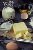 Baking ingredients eggs, flour, sugar, butter, vanilla, cream Stock Photo