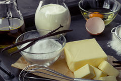 Baking ingredients eggs, flour, sugar, butter, vanilla, cream Royalty Free Stock Images