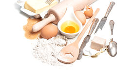 Baking ingredients eggs, flour, sugar, butter, yeast. Food backg Stock Photography