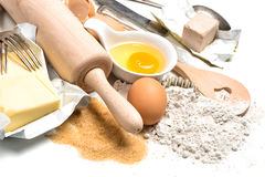 Baking ingredients eggs, flour, sugar, butter, yeast Stock Photography