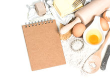 Baking ingredients eggs, flour, sugar, butter, yeast and recipe Stock Photos