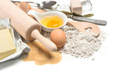 Baking ingredients eggs, flour, sugar, butter, yeast Royalty Free Stock Photos