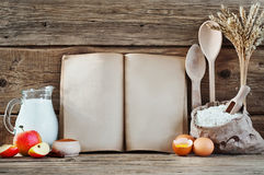 Baking ingredients eggs, flour, wheat, cinnamon, milk, apples Royalty Free Stock Image