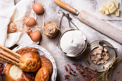 Baking ingredients - flour, butter, eggs, sugar. Baked flour-based food: bread, cookies, cakes, pastries, pies. Top view. Royalty Free Stock Photo